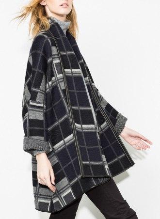 En mezcla de lana y con vivos de piel de Uterqüe - http://www.uterque.com/es/es/colección/prenda-exterior/capa-cuadros-c334510p4383347.html?color=401
